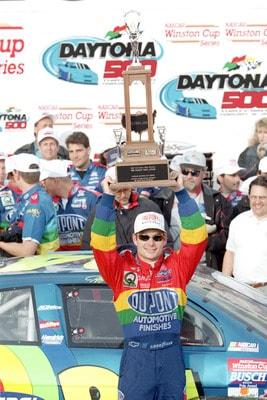 DAYTONA BEACH, FL - FEBRUARY 16: Jeff Gordon #24 of DuPont Chevrolet Monte Carlo hoist his trophy as he celebrates winning the NASCAR Daytona 500 at Daytona International Speedway on February 16, 1997 in Daytona Beach, Florida. (Photo by Andy Lyons/Getty Images)